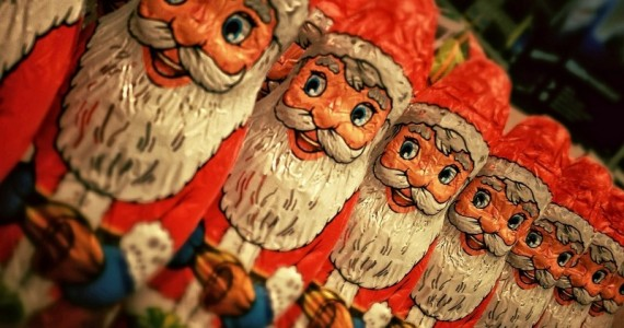 row-of-santa-claus-figurines-made-of-chocolate